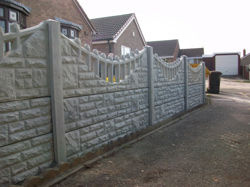 Decorative gravel boards tops bentinck fencing for Decorative wall fence